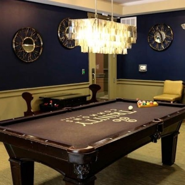 Hey Trinity Commons Residents! Too hot to hang outside? Come have some fun in our game room which features billiards, shuffleboard, and a multi-game table top arcade system! #trinitycommons #thisisNWRliving #communityfeatures